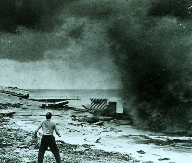 The Forceful Smashing of the Hurricane-Driven Wave Into the Seawall Demands and Receives Immediate Attention and Action - This Startled Man is Ready to Run, September 1947. Just North of Miami Beach, State of Florida, USA. Photo Credit: NOAA Central Library, National Oceanic and Atmospheric Administration Photo Library (http://www.photolib.noaa.gov, wea00411), Historic NWS Collection, National Oceanic and Atmospheric Administration (NOAA, http://www.noaa.gov), United States Department of Commerce (http://www.commerce.gov), Government of the United States of America (USA).
