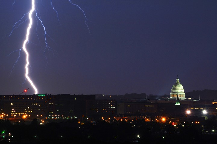 Nighttime Display of Nature's Power and the Symbol of Legislative Power -- Vivid Bolt of Lightning (left) Strikes Near the United States Capitol, Congress of the United States Building Complex (right), May 14, 2005. Washington, D.C. (District of Columbia), USA. Photo Credit: Tech. Sgt. Cherie A. Thurlby, Air Force Link - Week in Photos, May 20, 2005 (http://www.af.mil/weekinphotos/050520-10.html, 050514-F-7203T-005, 'D.C. shock'), United States Air Force (USAF, http://www.af.mil), United States Department of Defense (DoD, http://www.DefenseLink.mil or http://www.dod.gov), Government of the United States of America (USA).