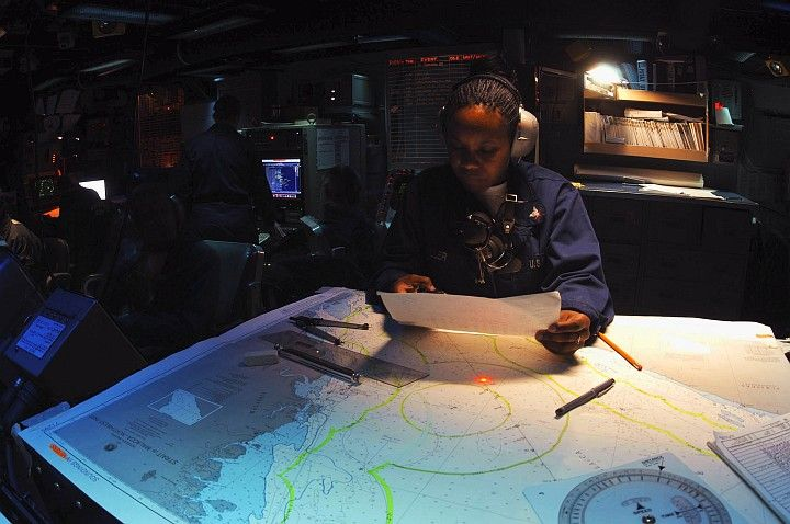 With Precision and Confidence She Plots the Course of the USS Bridge (AOE 10), September 10, 2003 in the Indian Ocean. Photo Credit: Photographer's Mate 2nd Class Monica L. McLaughlin, Navy NewsStand - Eye on the Fleet Photo Gallery (http://www.news.navy.mil/view_photos.asp, 030911-N-1671M-005), United States Navy (USN, http://www.navy.mil), United States Department of Defense (DoD, http://www.DefenseLink.mil or http://www.dod.gov), Government of the United States of America (USA).