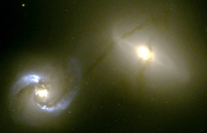 While Orbiting Each Other at 670,000 MPH (1 Million Kilometers per Hour), the Well-Defined Narrow (500 Light-years) and Very Long (20,000 Light-years) String of Material Continuously Flows Between NGC 1410 (Seyfert spiral galaxy, lower left) and NGC 1409 (upper right). Photo Credit: Intergalactic 'Pipeline' Funnels Matter Between Colliding Galaxies, October 25, 1999 (Release date: January 9, 2001), STScI-2001-02, NASA's Earth-orbiting Hubble Space Telescope (http://HubbleSite.org); William C. Keel (http://www.astr.ua.edu/keel, University of Alabama, Tuscaloosa, State of Alabama, USA), National Aeronautics and Space Administration (NASA, http://www.nasa.gov), Government of the United States of America (USA).