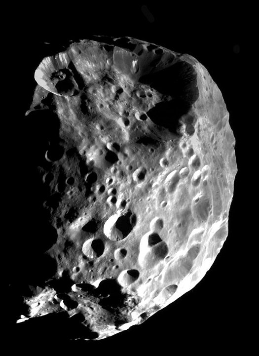A Spectacular View of Phoebe, a Moon of the Planet Saturn, Approximately 32,500 Kilometers (20,200 Miles) From the Cameras Aboard the Cassini Orbiter, June 11, 2004. Photo Credit: Cassini-Huygens Mission (http://saturn.jpl.nasa.gov), Cassini Orbiter, June 11, 2004; Planetary Photojournal (http://photojournal.jpl.nasa.gov, PIA06064), National Aeronautics and Space Administration (NASA, http://www.nasa.gov)/Jet Propulsion Laboratory (JPL, http://www.jpl.nasa.gov)/Space Science Institute (http://ciclops.org), Government of the United States of America.