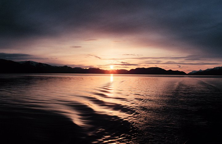 A Calming and Beautiful June 1991 Sunset Reflects Off of the Quiet Waters in Hoonah Sound, State of Alaska, USA. Photo Credit: Commander John Bortniak, NOAA Corps (ret.); National Oceanic and Atmospheric Administration Photo Library (http://www.photolib.noaa.gov, corp1777), NOAA Corps Collection, NOAA Central Library, National Oceanic and Atmospheric Administration (NOAA, http://www.noaa.gov), United States Department of Commerce (http://www.commerce.gov), Government of the United States of America (USA).