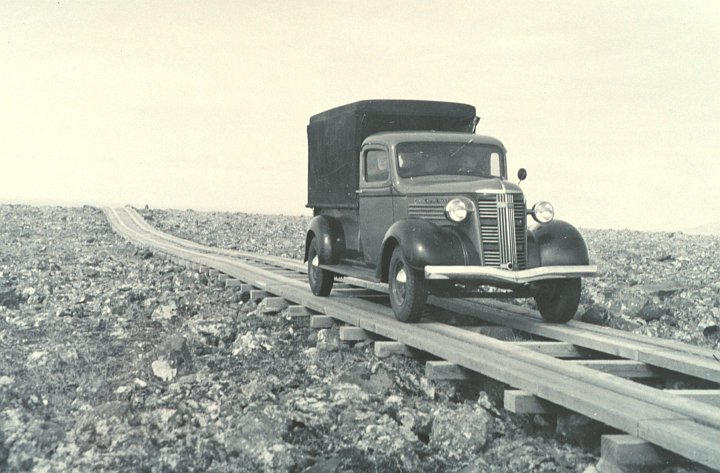 The Car Isn't On a Railroad Track, But a Narrow, One-Lane Plank (Wood) Road Constructed Over Rough Terrain, circa 1938. St. George, Pribilof Islands in the Bering Sea, State of Alaska, USA. Photo Credit: National Marine Fisheries Service; F&WS 10,067, National Oceanic and Atmospheric Administration Photo Library (http://www.photolib.noaa.gov, line1699), America's Coastlines Collection, National Oceanic and Atmospheric Administration (NOAA, http://www.noaa.gov), United States Department of Commerce (http://www.commerce.gov), Government of the United States of America (USA).