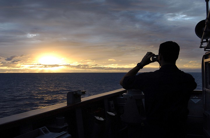 Photographing a Sunset -- the Start of a New Day -- in the Coral Sea. Photo Credit: Photographer's Mate 3rd Class Bo Flannigan, Navy NewsStand - Eye on the Fleet Photo Gallery (http://www.news.navy.mil/view_photos.asp, 050621-N-5781F-175), United States Navy (USN, http://www.navy.mil); United States Department of Defense (DoD, http://www.DefenseLink.mil or http://www.dod.gov), Government of the United States of America (USA).