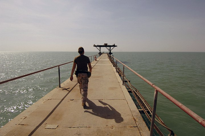 With the Waters of the Persian Gulf (North Arabian Gulf) on the Left and Right Sides, Underneath and Ahead She Confidently Walks to the Oil Terminal's Most Distant Point, June Khawr Al Amaya Oil Terminal (KAAOT), Al Jumhuriyah al Iraqiyah - Republic of Iraq. Photo Credit: Photographer's Mate 1st Class Aaron Ansarov, Navy NewsStand - Eye on the Fleet Photo Gallery (http://www.news.navy.mil/view_photos.asp, 050701-N-4309A-044), United States Navy (USN, http://www.navy.mil); United States Department of Defense (DoD, http://www.DefenseLink.mil or http://www.dod.gov), Government of the United States of America (USA).