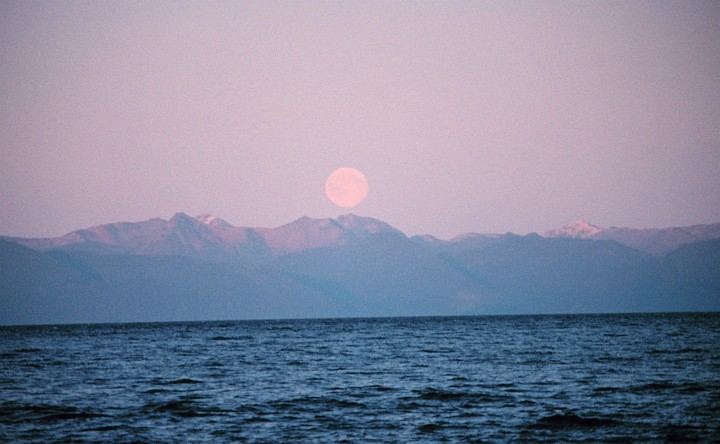 November 1991: Full Moon Rising in Chatham Strait, State of Alaska, USA. Photo Credit: Commander John Bortniak, NOAA Corps (retired); National Oceanic and Atmospheric Administration Photo Library (http://www.photolib.noaa.gov,corp1901), NOAA Corps Collection, NOAA Central Library, National Oceanic and Atmospheric Administration (NOAA, http://www.noaa.gov), United States Department of Commerce (http://www.commerce.gov), Government of the United States of America (USA).