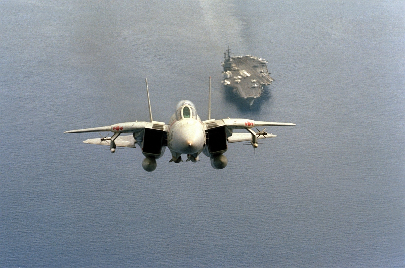 4. Front Air-to-Air View of a United States Navy F-14A Tomcat fighter jet -- Armed With Two AIM-54 Phoenix Missiles, Two AIM-7 Sparrow Missles, and Two AIM-9 Sidewinder Missiles -- Just After Takeoff From the Aircraft Carrier USS America (CV-66), January 1, 1984, Indian Ocean. Photo Credit: CW02 Leo, United States Navy (USN, http://www.navy.mil); Defense Visual Information Center (DVIC, http://www.DoDMedia.osd.mil and http://www.DefenseImagery.mil, DNSC8411122) and United States Navy (USN, http://www.navy.mil), United States Department of Defense (DoD, http://www.DefenseLink.mil or http://www.dod.gov), Government of the United States of America (USA).