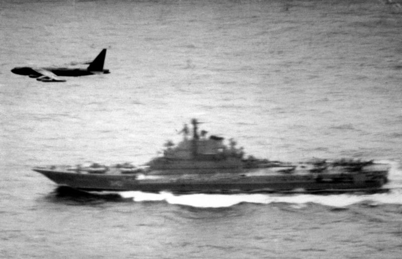 6. March 11, 1983: While On a Routine Maritime Reconnaissance Mission Over International Waters, A United States Air Force (USAF) Strategic Air Command (SAC) B-52D Stratofortress Heavy Bomber Flies Over the USSR Aircraft Carrier Kiev. Photo Credit: Defense Visual Information Center (DVIC, http://www.DoDMedia.osd.mil and http://www.DefenseImagery.mil, DFSN8306019), United States Department of Defense (DoD, http://www.DefenseLink.mil or http://www.dod.gov), Government of the United States of America (USA).