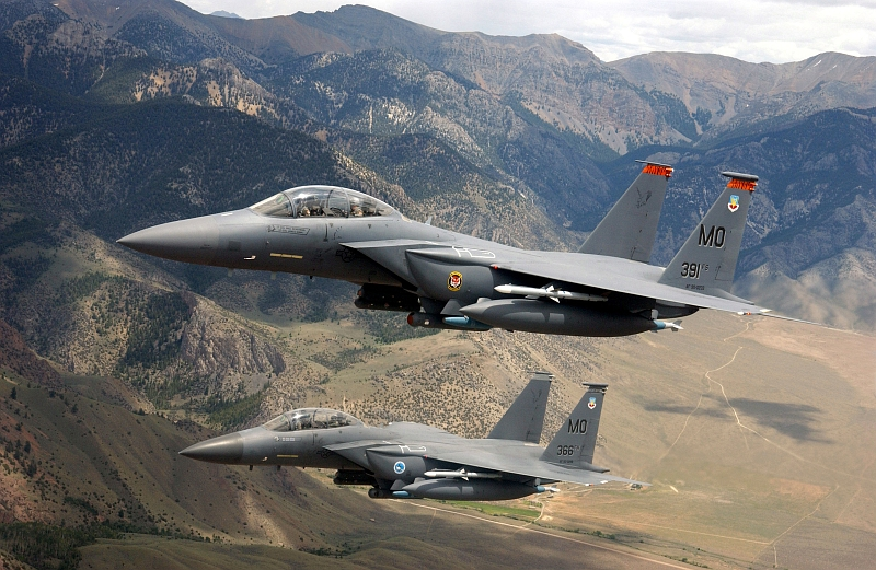 3. Two USAF F-15E Strike Eagle Fighter Jets Fly Low Over the Sawtooth Mountain Range  Photo Credit: Tech. Sgt. Debbie Hernandez, Air Force Link - Photos (http://www.af.mil/photos, 030624-F-8833H-050, 'Soaring Strike Eagles'), United States Air Force (USAF, http://www.af.mil), United States Department of Defense (DoD, http://www.DefenseLink.mil or http://www.dod.gov), Government of the United States of America (USA).