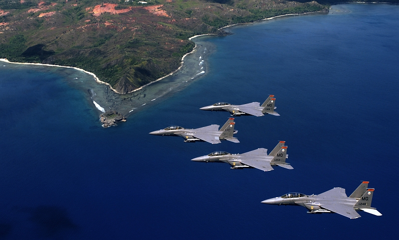 2. The Hills and Coast of Guam's Southern Point Are Visible As Four USAF F-15E Strike Eagle Fighter Jets Fly In Formation Over the Ocean, June 16, 2005, Territory of Guam, USA. Photo Credit: Tech. Sgt. Cecilio M. Ricardo, Air Force Link - Photos (http://www.af.mil/photos, 050617-F-3961R-290, 'Soaring like an Eagle'), United States Air Force (USAF, http://www.af.mil), United States Department of Defense (DoD, http://www.DefenseLink.mil or http://www.dod.gov), Government of the United States of America (USA).