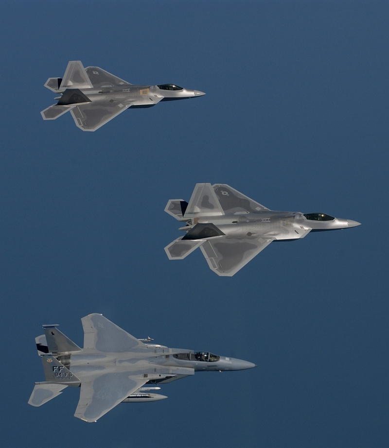 22. Two USAF F/A-22 (F-22A) Raptor Stealth Fighter Jets and A USAF F-15 Eagle Flying In Formation During A Training Sortie, August 12, 2005, Off the Coast of Langley Air Force Base (AFB), Commonwealth of Virginia, USA. Photo Credit: Tech. Sgt. Ben Bloke, United States Air Force; Defense Visual Information (DVI, http://www.DefenseImagery.mil, 050812-F-YL744-036) and United States Air Force (USAF, http://www.af.mil), United States Department of Defense (DoD, http://www.DefenseLink.mil or http://www.dod.gov), Government of the United States of America (USA).