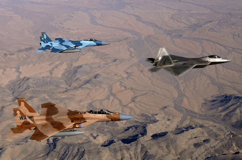 7. With Bare Mountains Below, Two USAF F-15 Eagle Fighter Jets (65th Aggressor Squadron) and One USAF F-22A Raptor Stealth Fighter Jet (422nd Test and Evaluation Squadron) Fly In Formation During A Training Mission Near Nellis Air Force Base, State of Nevada, USA, April 24, 2008. Photo Credit: Master Sgt. Scott Reed, United States Air Force; Defense Visual Information (DVI, http://www.DefenseImagery.mil, 080424-F-4884R-020) and United States Air Force (USAF, http://www.af.mil), United States Department of Defense (DoD, http://www.DefenseLink.mil or http://www.dod.gov), Government of the United States of America (USA).
