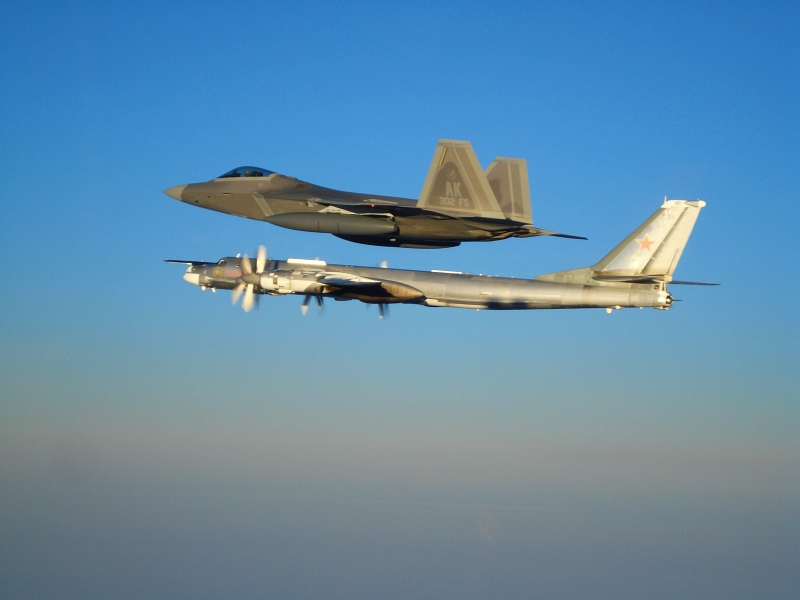 "11. Side By Side: A U.S. Air Force F-22A Raptor Stealth Fighter Jet Escorts A Russian Tu-95MS Strategic Heavy Bomber, November 22, 2007, Near Alaskan NORAD Region Airspace. Photo Credit: United States Air Force; Pacific Air Forces - Photos (http://www.pacaf.af.mil/photos, 081010-F-1234X-020, ""F-22 Raptor intercepts Russian bomber""), United States Department of Defense (DoD, http://www.DefenseLink.mil or http://www.dod.gov), Government of the United States of America (USA). Additional information provided by the USAF: Two F-22 Raptors from 11th Air Force, 3rd Wing, based at Elmendorf Air Force Base, Alaska intercepted a pair of Russian Tu-95MS strategic bombers on November 22, 2007. Both ""Bears"" belong to the 326th Heavy Bomber Air Division and are operated from Ukrainka air base. The intercept was a first for the Raptor."