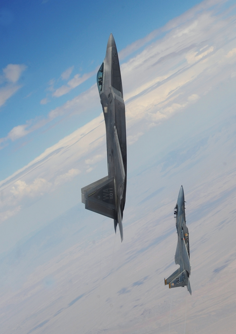 14. A U.S. Air Force F-22A Raptor Stealth Fighter and A U.S. Air Force F-15C Eagle Fighter Jet Pull Into a Vertical Climb Above the Nevada Test and Training Range (Officially Known As Nellis Air Force Range), July 16, 2010, State of Nevada, USA. Photo Credit: Master Sgt. Kevin J. Gruenwald, United States Air Force; United States Air Force; AF.mil - Photos (http://www.af.mil/photos, 100716-F-6911G-012), United States Department of Defense (DoD, http://www.DefenseLink.mil or http://www.dod.gov), Government of the United States of America (USA).
