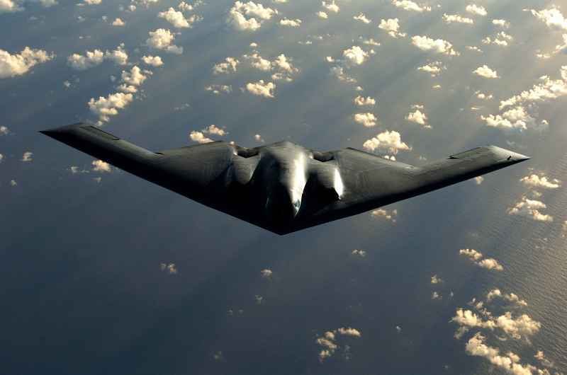 15. A U.S. Air Force B-2 Spirit Stealth Bomber Flying Over the Pacific Ocean, April 4, 2005. Photo Credit: Master Sgt. Val Gempis, United States Air Force; Defense Visual Information (DVI, http://www.DefenseImagery.mil, DF-SD-08-26862 and 050404-F-1740G-005) and United States Air Force (USAF, http://www.af.mil), United States Department of Defense (DoD, http://www.DefenseLink.mil or http://www.dod.gov), Government of the United States of America (USA).