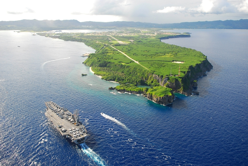 9. Aerial View of the U.S. Navy Nimitz-Class Aircraft Carrier USS Ronald Reagan (CVN 76) Pulling Into Agana Harbor, July 6, 2008, Territory of Guam, USA. Also visble are Apra Harbor, Point Udall (Orote Point), the long Orote Peninsula, and Agat Bay. Photo Credit: Mass Communication Specialist 2nd Class Jennifer S. Kimball, United States Navy; Defense Visual Information (DVI, http://www.DefenseImagery.mil, Still Image: 080706-N-0640K-001) and United States Navy (USN, http://www.navy.mil), United States Department of Defense (DoD, http://www.DefenseLink.mil or http://www.dod.gov), Government of the United States of America (USA).