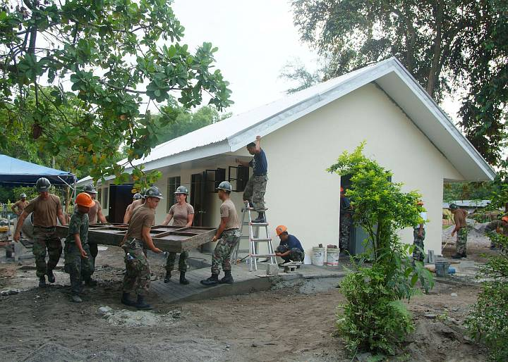 Construction Personnel From the Philippine Navy and the U.S. Navy Seabees Put the Finishing Touches on a Two-Room Schoolhouse Built at the Doce Martires Elementary School, August 19, 2005. San Narciso, Republika ng Pilipinas - Republic of the Philippines. Photo Credit: Journalist 2nd Class Brian P. Biller, Navy NewsStand - Eye on the Fleet Photo Gallery (http://www.news.navy.mil/view_photos.asp, 050819-N-4772B-009), United States Navy (USN, http://www.navy.mil), United States Department of Defense (DoD, http://www.DefenseLink.mil or http://www.dod.gov), Government of the United States of America (USA).
