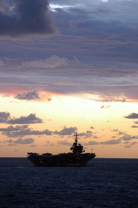 This is a Very Beautiful Sunset in the Coral Sea, June 23, 2005. Photo Credit: Photographer's Mate 3rd Class Bo J. Flannigan, Navy NewsStand - Eye on the Fleet Photo Gallery (http://www.news.navy.mil/view_photos.asp, 050623-N-5781F-713), United States Navy (USN, http://www.navy.mil); United States Department of Defense (DoD, http://www.DefenseLink.mil or http://www.dod.gov), Government of the United States of America (USA).