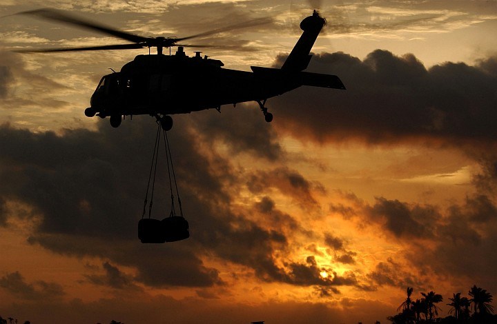 """Lungi, Republic of Sierra Leone, August 27, 2003: What a Beautiful Sunset! Also Visible is an HH-60G Pave Hawk Helicopter With the 56th Rescue Squadron, Naval Air Station Keflavik, Iceland. Photo Credit: Tech. Sgt. Justin D. Pyle, Air Force Link - Week in Photos, September 5, 2003 (http://www.af.mil/weekinphotos/030905-04.html, """"Into the setting sun""""), United States Air Force (USAF, http://www.af.mil), United States Department of Defense (DoD, http://www.DefenseLink.mil or http://www.dod.gov), Government of the United States of America (USA)."""
