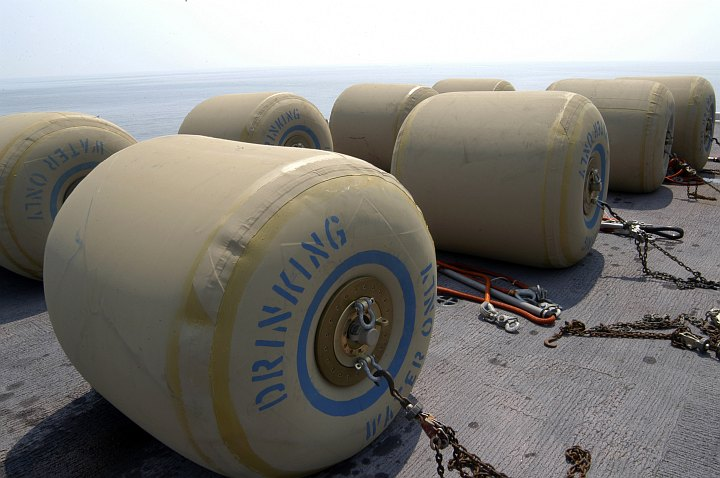 Hurricane Katrina Humanitarian Assistance, September 3, 2005, Gulf of Mexico: Eight Rubber Bladders Each Holding 500 Gallons of Fresh Drinking Water Aboard the Flight Deck of the Amphibious Assault Ship USS Bataan (LHD 5), United States Navy. Photo Credit: Photographer's Mate Airman Jeremy L. Grisham, Navy NewsStand - Eye on the Fleet Photo Gallery (http://www.news.navy.mil/view_photos.asp, 050903-N-8154G-244), United States Navy (USN, http://www.navy.mil); United States Department of Defense (DoD, http://www.DefenseLink.mil or http://www.dod.gov), Government of the United States of America (USA).