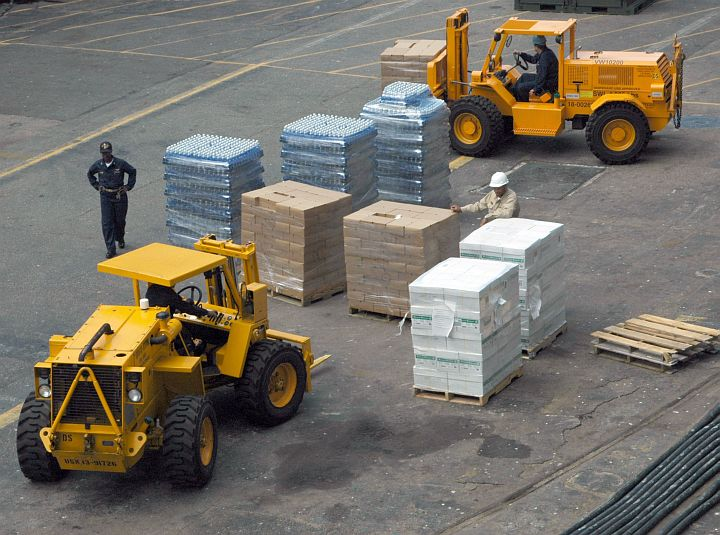 Hurricane Katrina Humanitarian Assistance, August 31, 2005: Forklifts Load Relief Supplies Onto the United States Navy Amphibious Assault Ship USS Iwo Jima (LHD 7), Naval Station Norfolk, Commonwealth of Virginia, USA. Photo Credit: Photographer's Mate 3rd Class Bradley Dawson, Navy NewsStand - Eye on the Fleet Photo Gallery (http://www.news.navy.mil/view_photos.asp, 050831-N-4781D-007), United States Navy (USN, http://www.navy.mil); United States Department of Defense (DoD, http://www.DefenseLink.mil or http://www.dod.gov), Government of the United States of America (USA).
