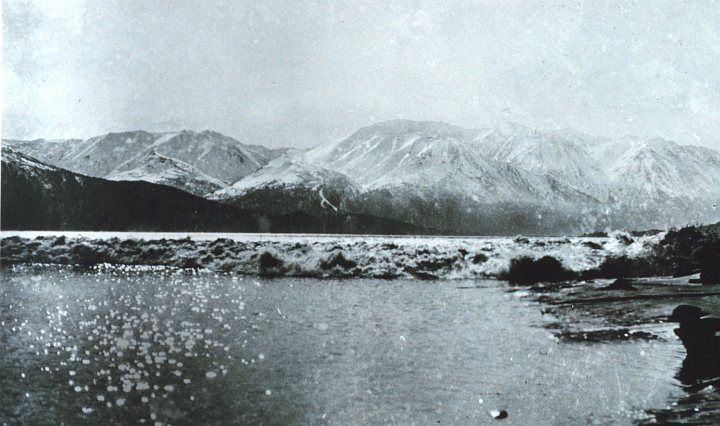 The Rapid Approach of the Tidal Bore in Turnagain Inlet, Upper Cook Inlet, State of Alaska, USA. Photo Credit: Archival photograph by Mr. Steve Nicklas, NGS/RSD; National Oceanic and Atmospheric Administration Photo Library (http://www.photolib.noaa.gov, line1769), America's Coastlines Collection, NOAA Central Library, National Oceanic and Atmospheric Administration (NOAA, http://www.noaa.gov), United States Department of Commerce (http://www.commerce.gov), Government of the United States of America (USA).