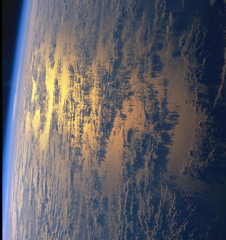 Space Shuttle Columbia (STS-93), July 25, 1999, 08:09:51 UTC: Planet Earth's Beautiful Golden Sunset With Low Clouds and Their Shadows Off the Eastern Coast of Republica Federativa do Brasil - Federative Republic of Brazil in the Western South Atlantic Ocean. Photo Credit: NASA's Space Shuttle Columbia: STS-93 Mission; NASA-Johnson Space Center. 'Astronaut Photography of Earth - Display Record.' <http://eol.jsc.nasa.gov/scripts/sseop/photo.pl?mission=STS093&roll=708&frame=37>; National Aeronautics and Space Administration (NASA, http://www.nasa.gov), Government of the United States of America (USA). The photo's full size request URL is <http://eol.jsc.nasa.gov/scripts/sseop/LargeImageAccess.pl?directory=ISD/highres/STS093&filename=STS093-708-37_4.JPG&filesize=2116094>