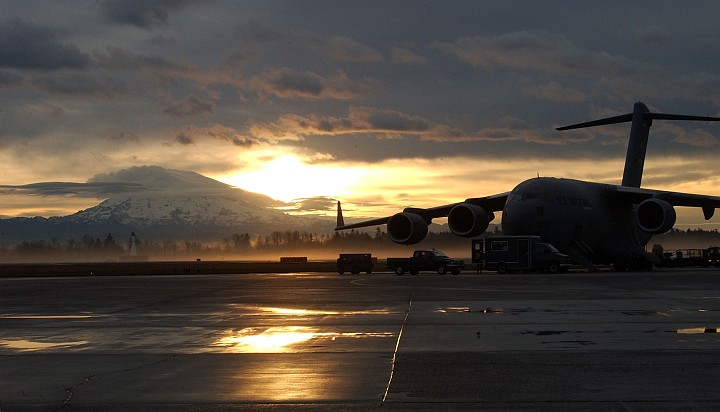 "Early in the Morning: Sunrise Over Mt. Rainier and McChord Air Force Base, State of Washington, USA. Photo Credit: Kristin Royalty, 62 Communications Squadron, McChord AFB; Air Force Link - Week in Photos, January 28, 2005 (http://www.af.mil/weekinphotos/050128-01.html, 050119-F-1601R-001, ""In the dawns early light""), United States Air Force (USAF, http://www.af.mil), United States Department of Defense (DoD, http://www.DefenseLink.mil or http://www.dod.gov), Government of the United States of America (USA)."