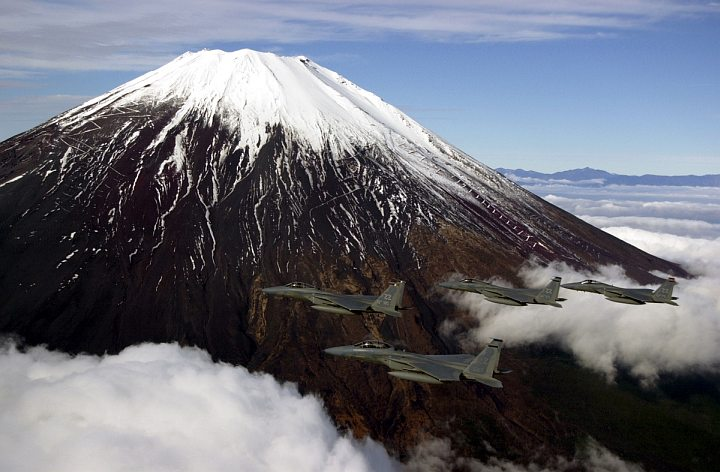 "Snow-Capped Mt. Fuji Above the Clouds, November 22, 2000, Nippon-koku (Nihon-koku) - Japan. Photo Credit: Master Sgt. Marvin Krause, 18th Communications Squadron; Air Force Link – Photos (http://www.af.mil/photos, 001122-F-1718K-013, ""Mount Fuji fly by""), United States Air Force (USAF, http://www.af.mil), United States Department of Defense (DoD, http://www.DefenseLink.mil or http://www.dod.gov), Government of the United States of America (USA)."