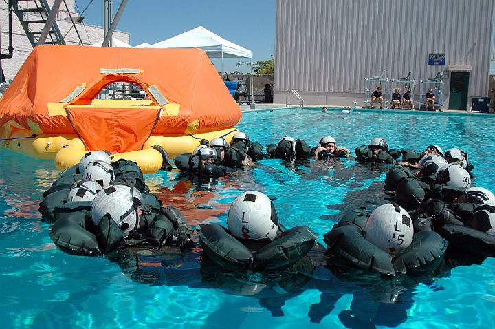 We Will -- We Must -- Stay Together: Seventeen (17) U.S. Navy Air Crewman Form a Circle in the Swimming Pool as They Simulate Open Ocean Survival Procedures to Prevent Anyone From Drifting Off Alone. Aviation Survival Training Center Miramar, Miramar, State of California, USA. Photo Credit: Photographer's Mate 2nd Class Daniel R. Mennuto, Navy NewsStand - Eye on the Fleet Photo Gallery (http://www.news.navy.mil/view_photos.asp, 050927-N-7286M-015), United States Navy (USN, http://www.navy.mil), United States Department of Defense (DoD, http://www.DefenseLink.mil or http://www.dod.gov), Government of the United States of America (USA).