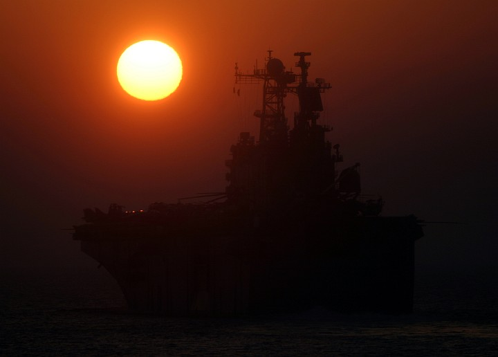 Our Sun (Sol), a Great Light, as It Sets Over the Strait of Hormuz, October 9, 2005. Photo Credit: Cryptologic Technician 2nd Class Aaron H. Leicht, Navy NewsStand - Eye on the Fleet Photo Gallery (http://www.news.navy.mil/view_photos.asp, 051009-N-7897L-001), United States Navy (USN, http://www.navy.mil); United States Department of Defense (DoD, http://www.DefenseLink.mil or http://www.dod.gov), Government of the United States of America (USA).
