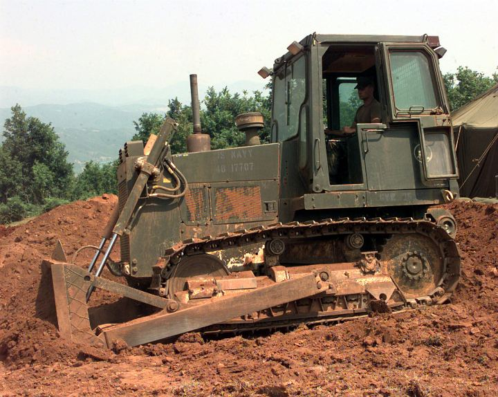 United States Navy Seebee's Use Heavy Equipment, a Bulldozer, to Flatten Out the Ground at Camp Wedge, Naval Mobile Construction Battalion FOUR (NMCB FOUR) on June 16, 1999 in Tirana, Republika e Shqiperise (Shqiperia) - Republic of Albania. Photo Credit: Photographer's Mate 2nd Class Brian McFadden, Navy NewsStand - Eye on the Fleet Photo Gallery (http://www.news.navy.mil/view_photos.asp, 990616-N-6019M-509), United States Navy (USN, http://www.navy.mil); United States Department of Defense (DoD, http://www.DefenseLink.mil or http://www.dod.gov), Government of the United States of America (USA).