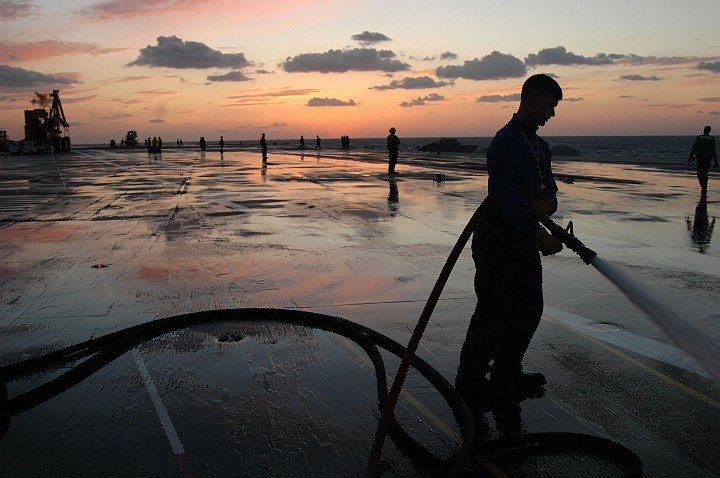 Washing Excess Soap and Foam From the Flight Deck of the USS Kitty Hawk (CV 63), October 24, 2005, Pacific Ocean. Photo Credit: Photographer's Mate Airman Benjamin Dennis, Navy NewsStand - Eye on the Fleet Photo Gallery (http://www.news.navy.mil/view_photos.asp, 051024-N-9389D-084), United States Navy (USN, http://www.navy.mil); United States Department of Defense (DoD, http://www.DefenseLink.mil or http://www.dod.gov), Government of the United States of America (USA).