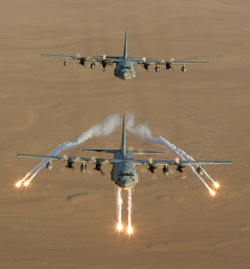 1. Aerial View of United States Marine Corps KC-130 Hercules Aircraft, Assigned to Marine Aerial Refueler-Transport Squadron Two Thirty Four (VMGR-234), As It Fires Flares That Are Used as a Defense Against Attacks by Surface to Air Missiles (SAMs or SAM) During Operation Iraqi Freedom, September 4, 2003, Al Jumhuriyah al Iraqiyah - Republic of Iraq. Photo Credit: Lance Corporal Andrew Z. Williams, United States Marine Corps (USMC, http://www.usmc.mil); September 4, 2003 Collection, Image ID: 030904-M-7837W-011, 2003 Image Gallery (http://www.tecom.usmc.mil/ccm/imu/galleries/MarForRes/03%20Submissions/Sept/Sept_03.htm), MARFORRES Galleries (http://www.tecom.usmc.mil/ccm/imu/pages/Galleries/MARFORRES.htm), Marine Corps Combat Camera Management and Imagery Management Unit - Photo: Command Submissions (http://www.tecom.usmc.mil/ccm/IMU/pages/photo.htm), Marine Corps Combat Camera Management and Imagery Management Unit (http://www.tecom.usmc.mil/ccm/IMU/IMU.htm), USMC Training And Education Command (TECOM, http://www.tecom.usmc.mil), United States Marine Corps (USMC, http://www.usmc.mil); United States Department of Defense (DoD, http://www.DefenseLink.mil or http://www.dod.gov), Government of the United States of America (USA). See also ChamorroBible.org: Manguaguan na Palabran Si Yuus, Fagualo (Octubre) 10, 2004 <http://ChamorroBible.org/gpw/gpw-20041010.htm>.