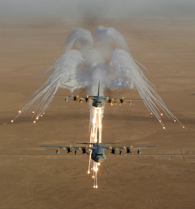 3. Another Aerial View of United States Marine Corps KC-130 Hercules Aircraft, Assigned to Marine Aerial Refueler-Transport Squadron Two Thirty Four (VMGR-234), As It Fires Flares Used to Counter an Attack by Surface to Air Missiles (SAMs or SAM) During Operation Iraqi Freedom, September 4, 2003, Al Jumhuriyah al Iraqiyah - Republic of Iraq. Photo Credit: Lance Cpl. Andrew Z. Williams, United States Marine Corps (USMC, http://www.usmc.mil); September 4, 2003 Collection, Image ID: 030904-M-7837W-011, 2003 Image Gallery (http://www.tecom.usmc.mil/ccm/imu/galleries/MarForRes/03%20Submissions/Sept/Sept_03.htm), MARFORRES Galleries (http://www.tecom.usmc.mil/ccm/imu/pages/Galleries/MARFORRES.htm), Marine Corps Combat Camera Management and Imagery Management Unit - Photo: Command Submissions (http://www.tecom.usmc.mil/ccm/IMU/pages/photo.htm), Marine Corps Combat Camera Management and Imagery Management Unit (http://www.tecom.usmc.mil/ccm/IMU/IMU.htm), USMC Training And Education Command (TECOM, http://www.tecom.usmc.mil), United States Marine Corps (USMC, http://www.usmc.mil); United States Department of Defense (DoD, http://www.DefenseLink.mil or http://www.dod.gov), Government of the United States of America (USA). See also ChamorroBible.org: Manguaguan na Palabran Si Yuus, Fagualo (Octubre) 10, 2004 <http://ChamorroBible.org/gpw/gpw-20041010.htm>.