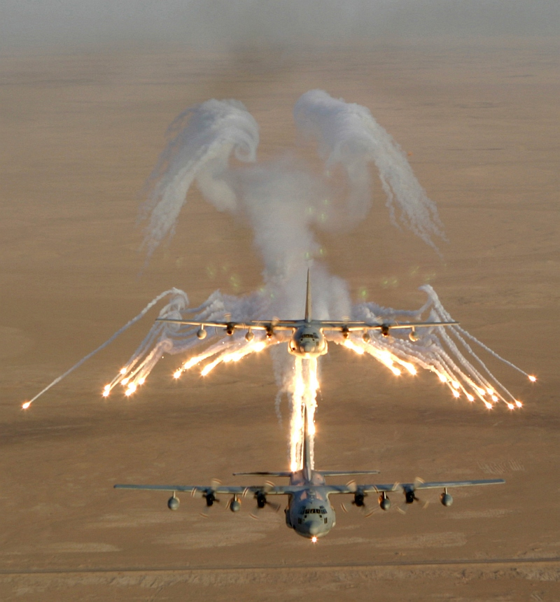 2. Aerial View of United States Marine Corps KC-130 Hercules Aircraft, Assigned to Marine Aerial Refueler-Transport Squadron Two Thirty Four (VMGR-234), As It Fires Flares Which Are Used to Counter an Attack by Surface to Air Missiles (SAMs or SAM) During Operation Iraqi Freedom, September 4, 2003, Al Jumhuriyah al Iraqiyah - Republic of Iraq. Photo Credit: Lance Cpl. Andrew Z. Williams, United States Marine Corps (USMC, http://www.usmc.mil); Defense Visual Information Center (DVIC, http://www.DoDMedia.osd.mil, DMSD0511421 and 030904M7837W014) and United States Marine Corps (USMC, http://www.usmc.mil), United States Department of Defense (DoD, http://www.DefenseLink.mil or http://www.dod.gov), Government of the United States of America (USA).