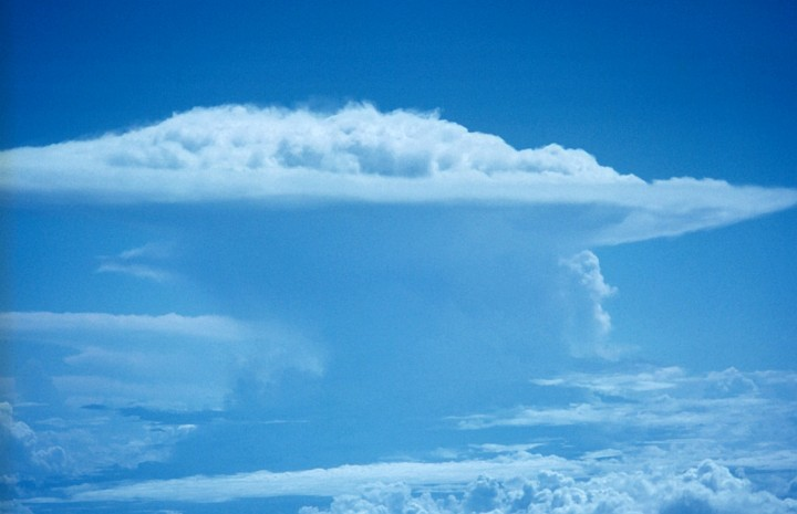 Surrounded by the Blue Sky, The Perfect Thunderstorm Impressively Towers Above the Clouds, October 6, 1972 at 18:45 UTC. Photo Credit: NOAA/AOML/Hurricane Research Division, National Oceanic and Atmospheric Administration Photo Library (http://www.photolib.noaa.gov, fly00890), Flying with NOAA Collection, NOAA Central Library, National Oceanic and Atmospheric Administration (NOAA, http://www.noaa.gov), United States Department of Commerce (http://www.commerce.gov), Government of the United States of America (USA).