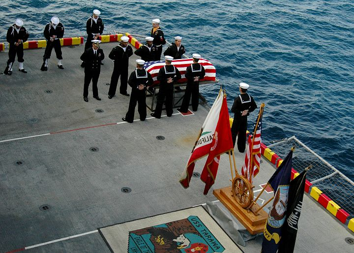 The Burial At Sea ceremony on January 22, 2004 aboard the U.S. Navy USS Tarawa (LHA 1), San Diego, State of California, USA. Photo Credit: Photographer's Mate Airman Matthew Clayborne, Navy NewsStand - Eye on the Fleet Photo Gallery (http://www.news.navy.mil/view_photos.asp, 050122-N-5517C-053), United States Navy (USN, http://www.navy.mil); United States Department of Defense (DoD, http://www.DefenseLink.mil or http://www.dod.gov), Government of the United States of America (USA).