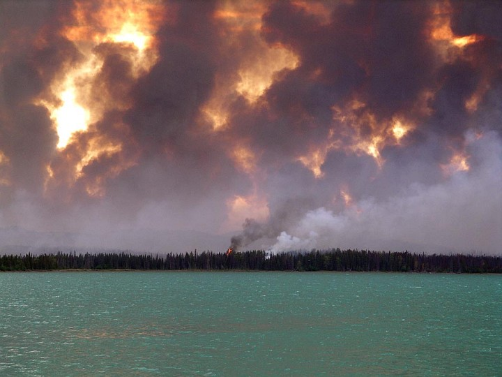 Fire and Smoke From the King County Creek Fire 2005 as Seen From Skilak Lake in Kenai National Wildlife Refuge, State of Alaska, USA. Photo Credit: U.S. Fish and Wildlife Service, Alaska Image Library, United States Fish and Wildlife Service Digital Library System (http://images.fws.gov, DI-Fire Pictures 2005 050), United States Fish and Wildlife Service (FWS, http://www.fws.gov), United States Department of the Interior (http://www.doi.gov), Government of the United States of America (USA).