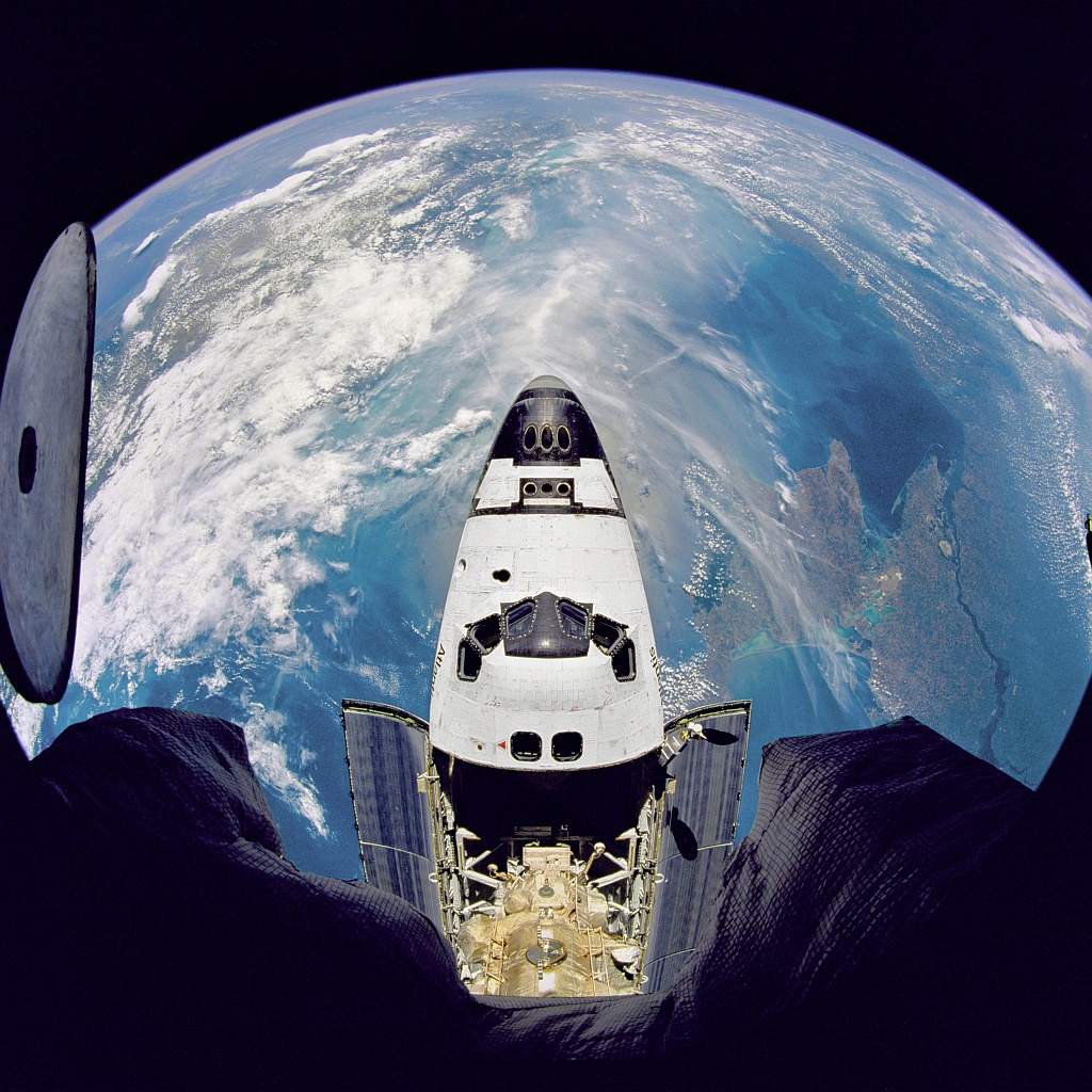 4. Beautiful Earth and NASA's Space Shuttle Atlantis (STS-71), July 2, 1995, As Seen From the Russian Federation Mir Space Station, Latitude (LAT): 44.6, Longitude (LON): 37.0, Altitude (ALT): 210 Nautical Miles, Sun Azimuth (AZI): 240 degrees, Sun Elevation Angle (ELEV): 57 degrees. Photo Credit: NASA; Fisheye view of Earth and NASA's Space Shuttle Atlantis as seen from Russia's Mir Space Station, GRIN (http://grin.hq.nasa.gov) Database Number: GPN-2000-001039 (STS071-741-004 or STS071-741-4), ), National Aeronautics and Space Administration (NASA, http://www.nasa.gov), Government of the United States of America.