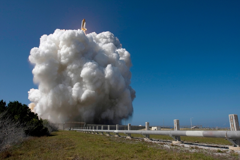 23. Space Shuttle Discovery (STS-124) Emerges From Behind a Growing Cloud of Smoke During Liftoff, May 31, 2008, NASA Kennedy Space Center, State of Florida, USA. Photo Credit: Sandra Joseph, Tony Gray, Robert Murray, and Mike Kerley; Kennedy Media Gallery (http://mediaarchive.ksc.nasa.gov) Photo Number: KSC-08PD-1554, John F. Kennedy Space Center (KSC, http://www.nasa.gov/centers/kennedy), National Aeronautics and Space Administration (NASA, http://www.nasa.gov), Government of the United States of America.