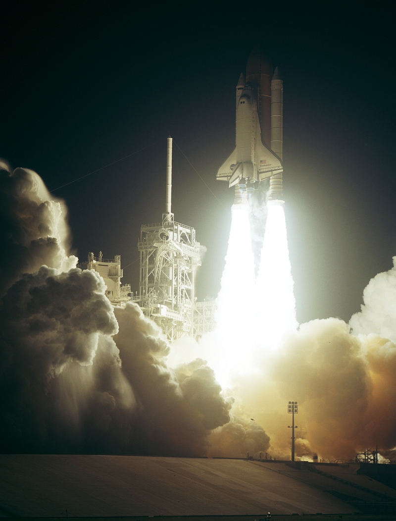7. Huge Clouds of Steam and Smoke Roll Across Launch Pad 39A As Space Shuttle Endeavour (STS-123), Riding Atop Twin Pillars of Fire, Lifts Off Into Space on March 11, 2008 at 2:28 a.m. EDT - 06:28 GMT, NASA John F. Kennedy Space Center, State of Florida, USA. Photo Credit: NASA, Rick Wetherington, Tim Terry, and Tim Powers; Kennedy Media Gallery - STS-123 (http://mediaarchive.ksc.nasa.gov) Photo Number: KSC-08PP-0734, John F. Kennedy Space Center (KSC, http://www.nasa.gov/centers/kennedy), National Aeronautics and Space Administration (NASA, http://www.nasa.gov), Government of the United States of America.