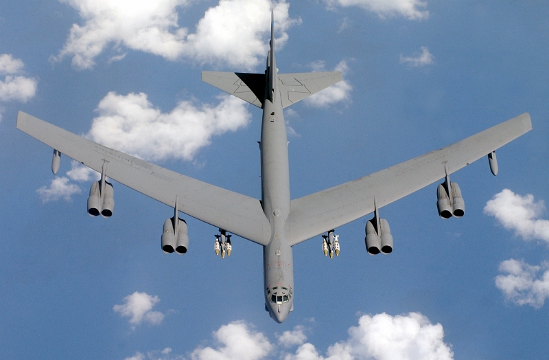 13. Top-Down, Aerial View of a U.S. Air Force (USAF) B-52 Stratofortress, Assigned to the 40th Expeditionary Bomb Squadron (EBS), Loaded With Joint Direct Attack Munitions (JDAM) During Operation Iraqi Freedom, April 15, 2003. Photo Credit: Tech. Sgt. (TSgt.) Richard Freeland, United States Air Force; Defense Visual Information (DVI, http://www.DefenseImagery.mil, 030415-F-7194F-015 and DF-SD-05-05787) and United States Air Force (USAF, http://www.af.mil), United States Department of Defense (DoD, http://www.DefenseLink.mil or http://www.dod.gov), Government of the United States of America (USA).