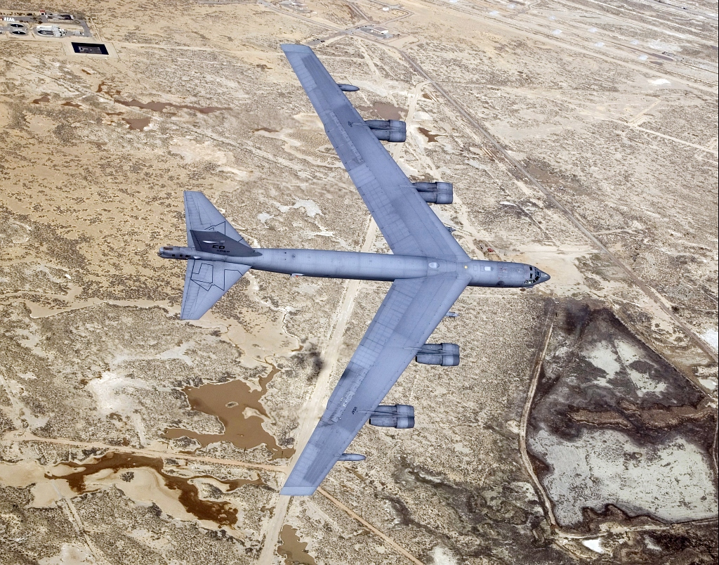 6. U.S. Air Force B-52 Stratofortress Bomber Flies Over Edwards Air Force Base, December 2, 2004, State of California, USA. Photo Credit: Bobbi C. Garcia, Civ, United States Air Force (USAF, http://www.af.mil); Defense Visual Information Center (DVIC, http://www.DoDMedia.osd.mil, DF-SD-07-40888 and 041202-F-9126G-039) and United States Air Force (USAF, http://www.af.mil), United States Department of Defense (DoD, http://www.DefenseLink.mil or http://www.dod.gov), Government of the United States of America (USA).