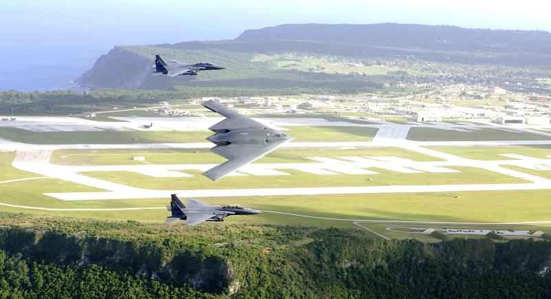 "1. Natural Beauty, U.S. National Defense Power and Strength: A Commanding Aerial View of the Ocean and Cliffs, Andersen Air Force Base, and the B-2 Spirit Stealth Bomber and Two F-15E Strike Eagle Fighter Jets Flying in Formation Over Andersen Air Force Base, July 2005. Territory of Guam, USA. Photo Credit: Tech. Sgt. Cecilio M. Ricardo, Air Force Link - Photos (http://www.af.mil/photos, 060707-F-3961R-001, ""Joining forces""), United States Air Force (USAF, http://www.af.mil), United States Department of Defense (DoD, http://www.DefenseLink.mil or http://www.dod.gov), Government of the United States of America (USA). See also ChamorroBible.org: Manguaguan na Palabran Si Yuus, Tenjos (Agosto) 22, 2005 <http://ChamorroBible.org/gpw/gpw-20050822.htm>."
