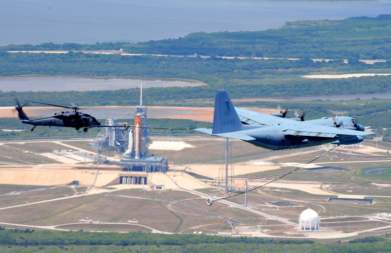 "20. As Space Shuttle Atlantis (STS-125) Sits On Launch Pad 39A, a U.S. Marine Corps C-130 Hercules Refuels a U.S. Air Force 920th Rescue Wing (RQW) HH-60G Pave Hawk Helicopter, May 11, 2009 Photo Credit: Tech. Sgt. Gillian M. Albro, 920th Rescue Wing, Air Force Reserve Command; Air Force Link - Photos (http://www.af.mil/photos, 090511-F-0403A-001, ""Astronaut Rescuers Refuel""), United States Air Force (USAF, http://www.af.mil), United States Department of Defense (DoD, http://www.DefenseLink.mil or http://www.dod.gov), Government of the United States of America (USA)."
