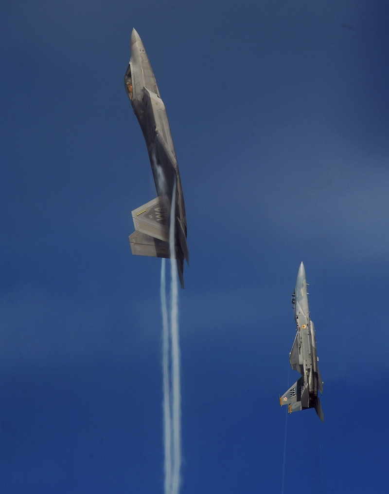 17. A U.S. Air Force F-22A Raptor Stealth Fighter and a U.S. Air Force F-15C Eagle Fighter Jet Pull Into a Vertical Climb Over the Nevada Test and Training Range (Officially Known As Nellis Air Force Range), July 16, 2010, State of Nevada, USA. Photo Credit: Master Sgt. Kevin J. Gruenwald, United States Air Force; United States Air Force; AF.mil - Photos (http://www.af.mil/photos, 100716-F-6911G-491), United States Department of Defense (DoD, http://www.DefenseLink.mil or http://www.dod.gov), Government of the United States of America (USA).