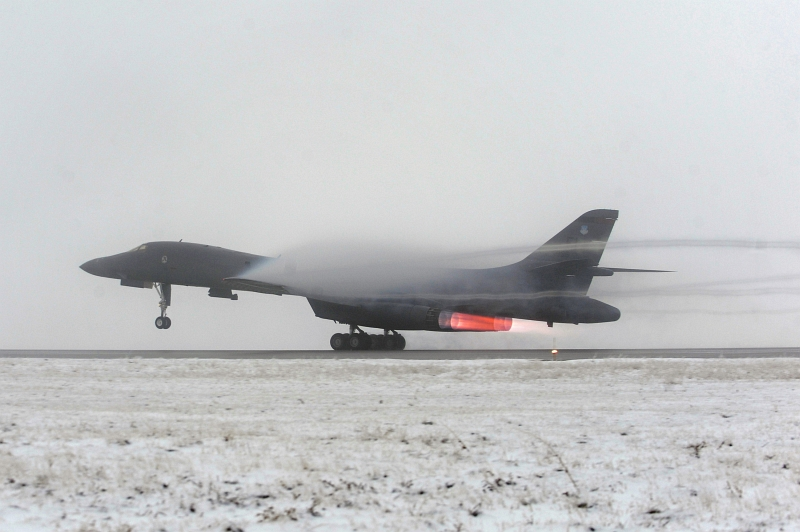 25. A U.S. Air Force B-1B Lancer Long-Range, Supersonic, Heavy Bomber Takes Off In Support of Operation Odyssey Dawn, March 27, 2011, Ellsworth Air Force Base, State of South Dakota, USA. Photo Credit: Staff. Sgt. Marc I. Lane, United States Air Force; Defense Visual Information (DVI, http://www.DefenseImagery.mil, 110327-F-VK137-803) and United States Air Force (USAF, http://www.af.mil), United States Department of Defense (DoD, http://www.DefenseLink.mil or http://www.dod.gov), Government of the United States of America (USA).