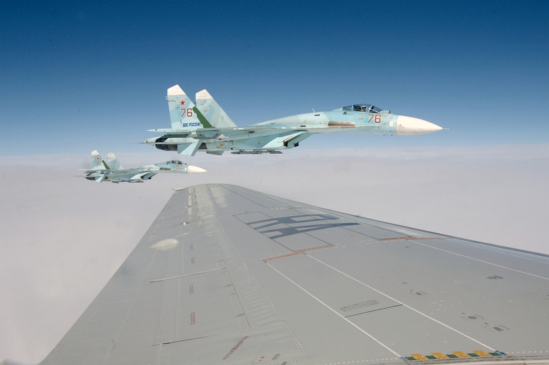 27. Joint NORAD-Russia Exercise VIGILANT EAGLE: High Above the Pacific Ocean, Two Russian Federation Air Force Su-27 Fighter Jets Intercept and Escort an Airliner During the International Hijacking Senario, August 9, 2011. Photo Credit: Tech. Sgt. Thomas J. Doscher, United States Air Force; North American Aerospace Defense Command (NORAD, http://www.norad.mil, 110809-F-YX459-164), United States Department of Defense (DoD, http://www.DefenseLink.mil or http://www.dod.gov), Government of the United States of America (USA).