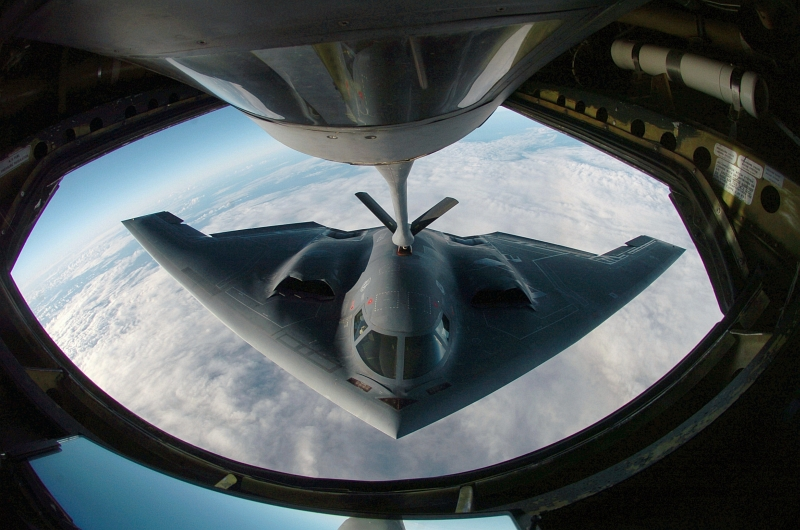 18. A U.S. Air Force B-2 Spirit Stealth Bomber Refuels From an Illinois Air National Guard KC-135 Stratotanker Over the Pacific Ocean, April 4, 2005. Photo Credit: Master Sgt. Val Gempis, United States Air Force; Defense Visual Information (DVI, http://www.DefenseImagery.mil, DF-SD-07-04347 and 050404-F-1740G-001) and United States Air Force (USAF, http://www.af.mil), United States Department of Defense (DoD, http://www.DefenseLink.mil or http://www.dod.gov), Government of the United States of America (USA).